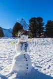 Snowman under Matterhorn Royalty Free Stock Image