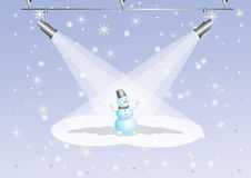 Snowman under searchlights Stock Images