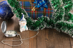 Snowman, vintage watch, a bowl and a gift Stock Images