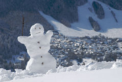 Snowman visiting mountains Royalty Free Stock Images