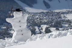 Snowman visiting mountains Royalty Free Stock Image