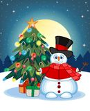 Snowman Wearing A Hat, Red Sweater And Red Scarf Waving His Hand With Christmas Tree And Full Moon At Night Background For Your De Royalty Free Stock Photos