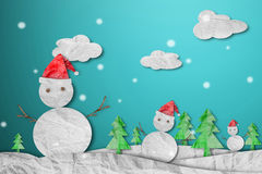 Snowman wearing red Santa hat in winter with snow, paper cut made of crumpled paper, Christmas Background Royalty Free Stock Photography