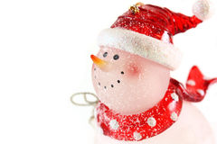 Snowman on white background. Snowman close up with red hat on white background stock images