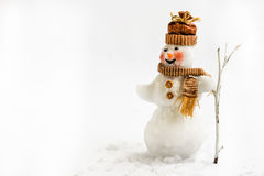 Snowman on a white background with broom Stock Images