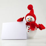 Snowman with white paper Royalty Free Stock Image