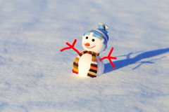 Snowman on white snow Royalty Free Stock Images