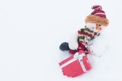 Snowman on the white snow in winter background for New Year. Royalty Free Stock Photos