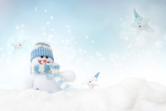Snowman on the winter background stock photo