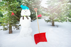 Snowman during winter day in fir tree forest Royalty Free Stock Image