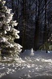 Snowman in winter forest Stock Photography