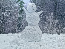 Snowman in winter forest Royalty Free Stock Images