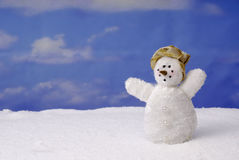 Snowman in winter landscape Stock Photo
