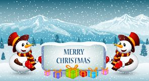 Snowman in winter with mountain background Royalty Free Stock Photo