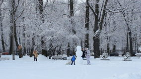 Snowman in a winter park.