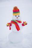 Snowman in winter park Stock Photo