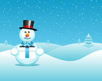 Snowman in Wintry landscape Royalty Free Stock Photo