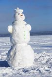 Snowman on a wintry sunny day Stock Photo