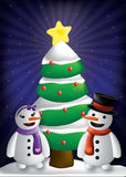 Snowman and Woman w Christmas tree. A christmas setting with snowman and snow woman with the christmas tree on a blue snowy sky Stock Photos
