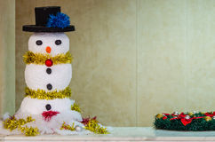 Snowman on a wood background Stock Photo
