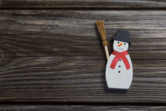 Snowman on wooden background for christmas decoration. Stock Photos