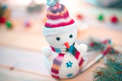 Snowman on a wooden background. New Year`s still life. Snowman on a wooden background. New Year`s still life Royalty Free Stock Photo