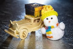 Snowman and wooden car with gift box Royalty Free Stock Images