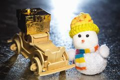 Snowman and wooden car with gift box Stock Photography