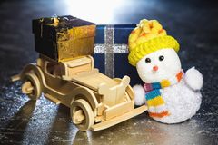 Snowman and wooden car with gift boxes Stock Photos