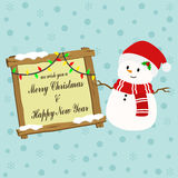 Snowman and Wooden Christmas Greeting Sign Royalty Free Stock Photos