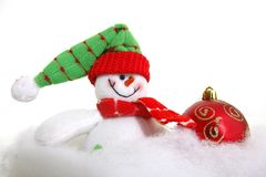 Snowman and xmas ball in snow Royalty Free Stock Image