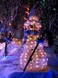 Snowman with Xmas Lights Royalty Free Stock Photos