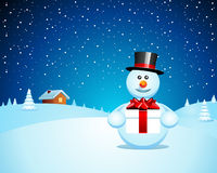 Snowman with Xmas present Stock Photography