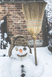 Snowman in the yard Royalty Free Stock Photography