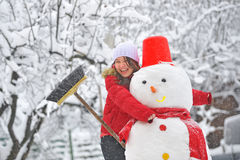 Snowman and young girl Stock Photos