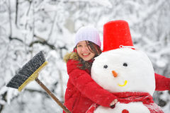 Snowman and young girl Royalty Free Stock Images