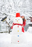 Snowman and young girl Royalty Free Stock Photography