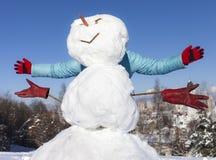 Snowmanen med människa räcker Arkivbilder