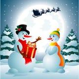 Snowmaninnehav per gåva från Jultomte Fotografering för Bildbyråer