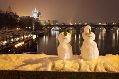 Snowmans and Charles Bridge as background, Czech Republic Stock Photography