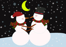Snowmans looking at each other in the moonlight light. Stock Photo