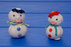 Snowmans on  New Year`s post card, snowmans on Christmas card, h. Andmade snowmans,  syntepon New-Year tree decorations Royalty Free Stock Photos