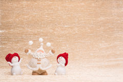Snowmans and Santa Claus. On illuminated background Stock Images
