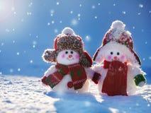Snowmans sur la neige Photographie stock