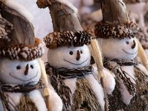 Snowmen. Three snowmen figures made of natural materials Royalty Free Stock Images