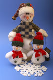 Snowmen. With snowflake on blue background Royalty Free Stock Images