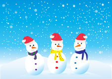 Snowmen. Vector three funny snowmen in santa hats Royalty Free Stock Photos