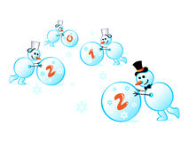 Snowmen 2012. Cheerful snowmen rolling 2012 snowballs Stock Photo