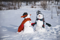 Snowmen. In love with funny clothes Royalty Free Stock Image