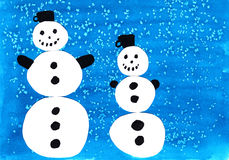 Snowmen. Two snowmen in the falling snow Stock Images